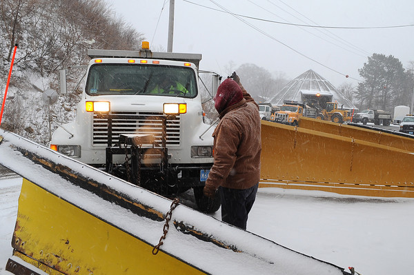 Gloucester: DPW  worker Tim Lodge directs a driver to a plow, as others load salt to other trucks they prepare for the the approaching storm Sunday afternoon at the DPW on Poplar St. Desi Smith/Gloucester Daily Times. December 26,2010.