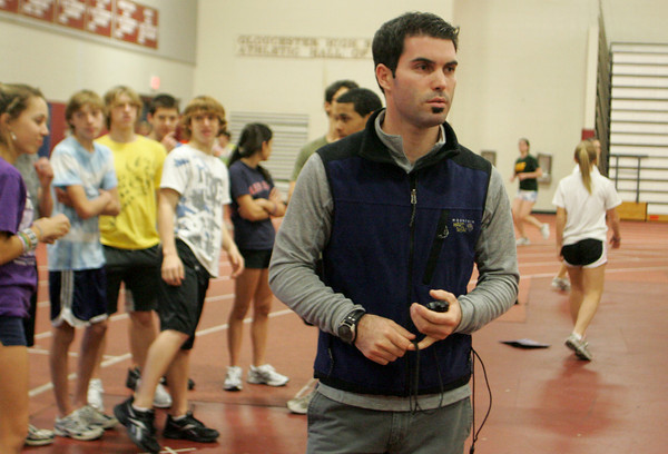 Gloucester: Jeff Destino watches sprinters run by during practice at Gloucester High School Thursday afternoon.  Destino has taken over as head track coach for Jim Munn. Mary Muckenhoupt/Gloucester Daily Times