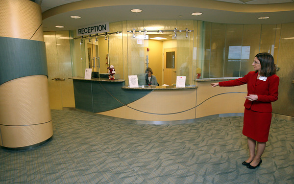 Gloucester: Cindy Donaldson, President of Addison Gilbert Hospital, shows how they used natural colors and curves to mimic the ocean in the design of the Gorton's Cancer Center. Photo by Kate Glass/Gloucester Daily Times