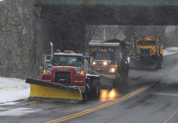 Gloucester: City contractors in their plow trucks sit under the 128 overpass on Concord St just as the storm starts up Sunday afternoon. Desi Smith/Gloucester Daily Times. December 26,2010.