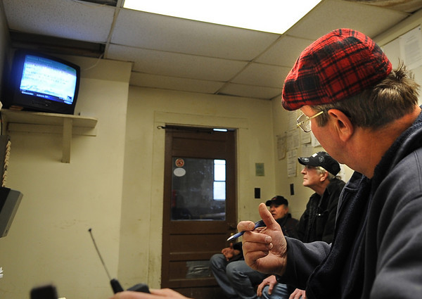 Gloucester: DPW formen Peter Dennen talks with his drivers as they watch the Weather Channal on the approaching storm Sunday afternoon at the DPW office on Poplar St. Desi Smith/Gloucester Daily Times. December 26,2010.