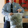 Gloucester: Gloucester patrolman Brian Aiello bags up five pounds of marijuana that was confiscated form two men from Vermont who were arrested Wednesday. Mary Muckenhoupt/Gloucester Daily Times
