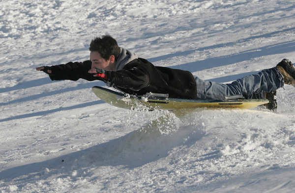 Gloucester: Sal Ciolino, 12, braces for the impact as he goes off a jump near Boudreau Field on Thursday afternoon. Photo by Kate Glass/Gloucester Daily Times