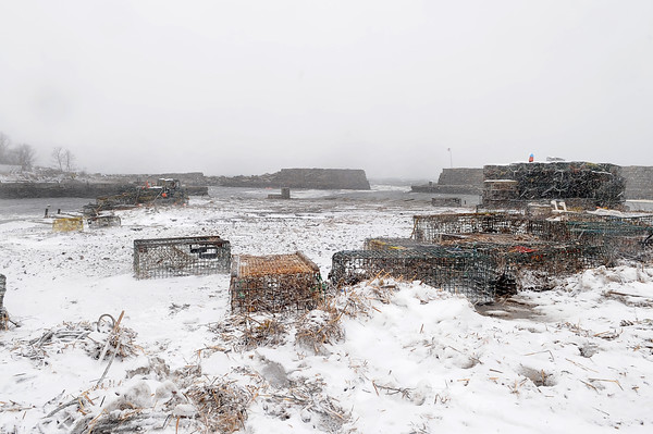 Gloucester: The Lanes Cove seawall was torn apart during Sunday night's storm. About 50 to 60 feet of the top wall as taken down. Desi Smith/Gloucester Daily Times. December 27,3010.
