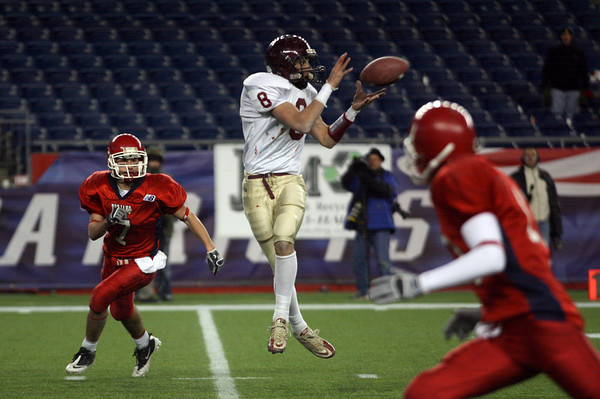 Foxborough: Gloucester's Mike Tomaino leaps to catch a pass from quarterback Joey Avila, which he ran in for a touchdown during the Division IA Super Bowl at Gillette Stadium on Saturday night. The Fishermen won 34-13. Photo by Kate Glass/Gloucester Daily Times