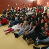 Gloucester: Students at the Gloucester Community Arts Charter School laugh as they see pictures of themselves in a slideshow during a pizza party yesterday celebrating the holidays and the school's green light for going foreward. Photo by Kate Glass/Gloucester Daily Times