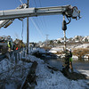 Gloucester: National Grid employees drill to install a new utility pole on Thatcher Road, which will support a pole that snapped in the recent snowstorm. Photo by Kate Glass/Gloucester Daily Times