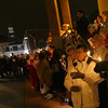 Gloucester: Dozens of people gather on the steps of BankGloucester for the lighting of the Hospice of the North Shore Tree of Lights on Monday night. Photo by Kate Glass/Gloucester Daily Times