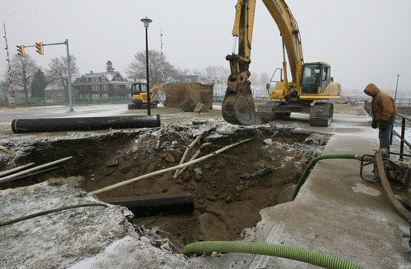 Gloucester: Water drains from the site of a water main break along Western Avenue, which caused significant drops in water pressure across the city, causing a boil-water order from the Department of Environmental Protection. Photo by Kate Glass/Gloucester Daily Times