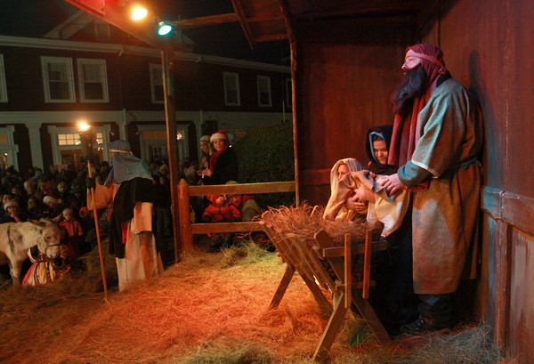 Rockport: Mary and Joseph welcome the birth of their chid Jesus in the manger in front of the First Congregational Church during the live Christmas Nativity Pageant Saturday night. This year Mary was played by Olivia Smith. Mary Muckenhoupt/Gloucester Daily Times