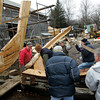 Essex: Harold Burnham, left, with the help of six men carry help put one of the last frames into place it as the framing process of the schooner  Ardelle is almost complete at H.A. Burnhams Boat Building and Design Saturday afternoon. Pictured, fom left, Burnham, Jeff Lane, Fritz Fuller, Chuck Redman, Jim Chambers, Bob Quadros, and Bob Pasternak.  Mary Muckenhoupt/Gloucester Daily Times