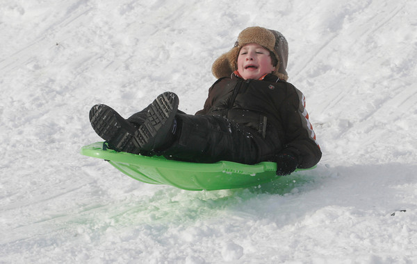 Essex: Collin Jackson, 8, gets some air as he goes off a jump behind the TOHP Burnham Library on Wednesday afternoon. Photo by Kate Glass/Gloucester Daily Times