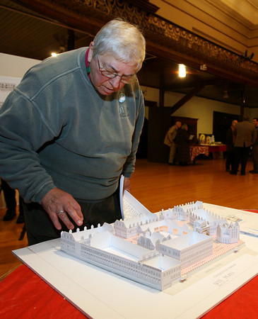 Gloucester: Sunny Robinson looks at Robert I. Mitnik's model of his proposal for the I4-C2 property during a reception at City Hall last night. Photo by Kate Glass/Gloucester Daily Times