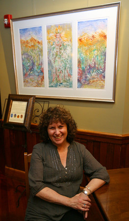 """Gloucester: Baraka Robin Berger is the first artist to have her work displayed in Alchemy's gallery """"The Alchemy of Art."""" Photo by Kate Glass/Gloucester Daily Times"""