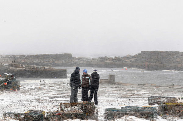 Gloucester: Glenn Deckert his wife Cheryl and daughter Jenny check out the damage at Lanes Cove Monday afternoon. Desi Smith/Gloucester Daily Times. December 27,3010.