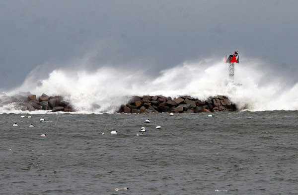Rockport: Waves crash over the Breakwater at the end of Bearskin Neck in Rockport at high tide yesterday. Photo by Kate Glass/Gloucester Daily Times