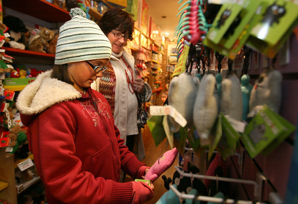 Gloucester: Jill Ortiz and her daughter, Andraya Ortiz, 10, browse through toys at Toodeloos during Ladies Night in Gloucester yesterday. Toodeloos was offering 20 percent off all their merchandise. Photo by Kate Glass/Gloucester Daily Times