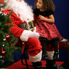 "Gloucester: Samara Salah, 4, tells Santa what she would like him to bring for Christmas during a taping of ""Santa Party!"" at the Cape Ann TV Studio. ""Santa Party!"" will air from 5:30 to 9:30 p.m. on Christmas Eve and from 6 a.m. to 1 p.m. and 5:30 to 9:00 p.m. on Christmas Day. Photo by Kate Glass/Gloucester Daily Times"