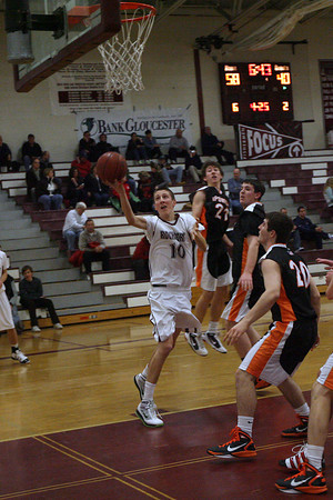 Gloucester: Rockport senior Dan Gray shoots over Ipswich junior Tyler Hale during the BankGloucester Holiday Tournament at the Benjamin A. Smith Fieldhouse last night. Photo by Kate Glass/Gloucester Daily Times