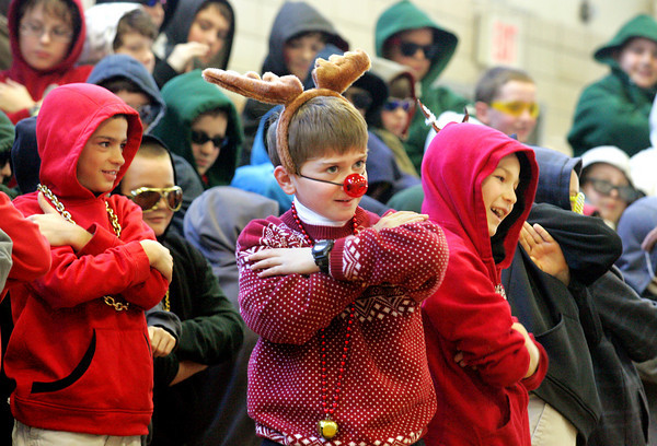 Manchester: Fifth grader Nathan Duda plays Rudolph while singing a holiday hip hop song with his classmates during the Holiday Concert at Manchester Memorial Elementary School Friday morning. Mary Muckenhoupt/Gloucester Daily Times