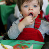 Essex: Andrew Pellegrini, 17 months, doesn't mind getting messy while eating the frosting off his gingerbread cookie during Breakfast with Santa at Essex Elementary School Saturday morning. Mary Muckenhoupt/Gloucester Daily Times