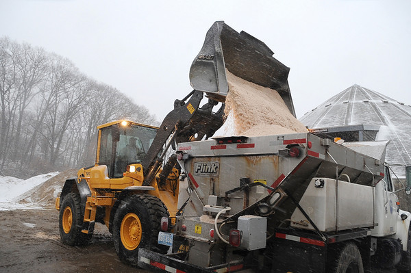 Gloucester: DPW  Head Mechanic Ron Garvay loads a sanding truck with salt,as they prepare for the the approaching storm Sunday afternoon at the DPW office on Poplar St. Desi Smith/Gloucester Daily Times. December 26,2010.