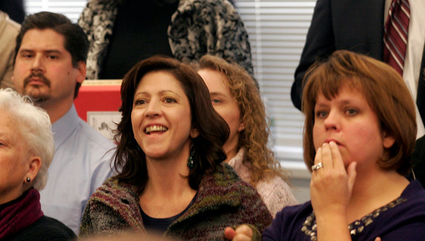 Malden: Jennifer Shulman cheers as she realizes the Board of Elementary and Secondary Education voted to keep the Gloucester Community Arts Charter School open during their meeting in Malden on Tuesday while Robert Bradshaw, left, and Ruthie Exama, right, count the votes. The three all have children enrolled in the Gloucester Community Arts Charter School. Photo by Kate Glass/Gloucester Daily Times