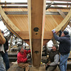 Essex: Harold Burnham, sitting left, secures one of the last frames into place with the help of, from left, Bob Pasternak, Wally Brooks, Chuck Redman, sitting left, and Jim Chambers as the framing process of the schooner Pinky Ardelle is almost complete at H.A. Burnhams Boat Building and Design Saturday afternoon. Burnham is eager to get the framing finsihed so he can start working on planking of the vessel which is being built for the Gloucester Maritime Heritage Center.  Mary Muckenhoupt/Gloucester Daily Times
