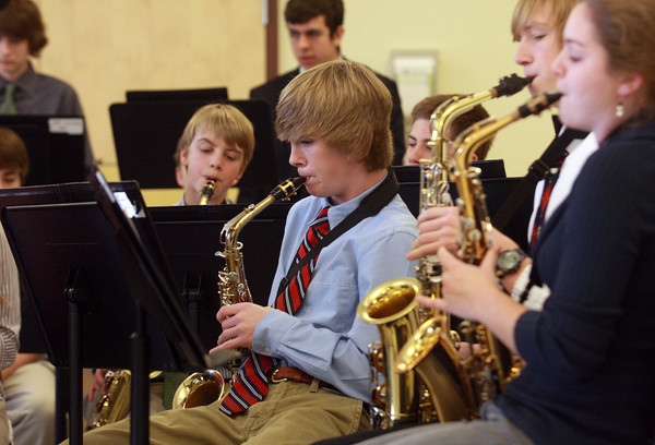 Manchester: Connor Booth plays the saxaphone as the Manchester Essex High School band performs for the Senior Citizen Holiday Luncheon in the school's cafeteria Saturday afternoon. Senior citizens from Manchester and Essex were invited to the school for lunch and live music. Mary Muckenhoupt/Gloucester Daily Times