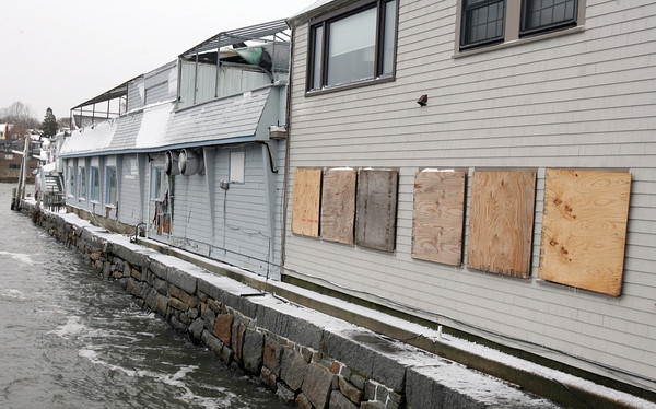 Rockport: Several windows were broken and shingles torn off buildings on Bearskin Neck during the high tide early Monday morning. Photo by Kate Glass/Gloucester Daily Times