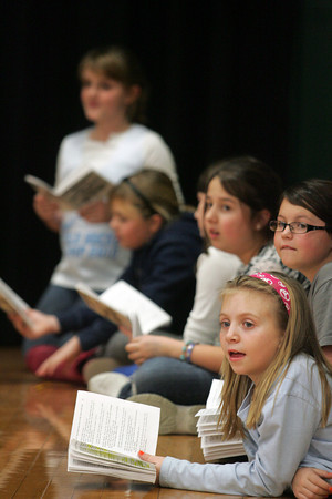 "Essex: Students, including Emily Beck, front, read their lines as they wait for their part to come up while rehearsing for ""The Surprising Story of the Three Little Pigs"" at the Essex Elementary School Wednesday afternoon.  The play will be performed February 10 and 11. Mary Muckenhoupt/Gloucester Daily Times"