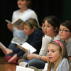 """Essex: Students, including Emily Beck, front, read their lines as they wait for their part to come up while rehearsing for """"The Surprising Story of the Three Little Pigs"""" at the Essex Elementary School Wednesday afternoon.  The play will be performed February 10 and 11. Mary Muckenhoupt/Gloucester Daily Times"""