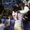Foxborough: Former Gloucester football players Brett Cahill, right, and Ryan Fulford, hug Bryan Ingersoll following the Fishermen's 34-13 win over Bridgewater-Raynham in the Division IA Super Bowl at Gillette Stadium on Saturday night. Photo by Kate Glass/Gloucester Daily Times