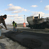 Gloucester: Employees of Joseph P. Cardillo & Son, Inc. spread asphalt over the site of a water main replacement along Western Avenue on Thursday. The project, which included parts of Essex Avenue, is near completion. Photo by Kate Glass/Gloucester Daily Times