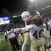 Foxborough: Gloucester's Gilbert Brown lifts teammate Brandon Cusumano as they celebrate their Super Bowl victory over Bridgewater-Raynham at Gillette Stadium on Saturday night. Photo by Kate Glass/Gloucester Daily Times