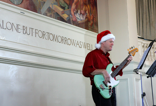 Gloucester: Gary Wolsieffer of Manchester plays the guitar as the Cape Ann Big Band plays holiday songs at City Hall as part of the Middle Street Walk Saturday afternoon. Mary Muckenhoupt/Gloucester Daily Times