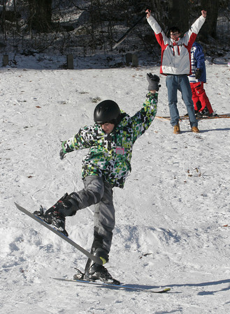 Rockport: Sean Flynn, 13, of Rockport gets some air as he skis over a jump at Evans Field yesterday afternoon. Photo by Kate Glass/Gloucester Daily Times