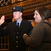 Gloucester: Amy Ruiter stands next to her husband, William Ruiter, as he is sworn in as a Gloucester Firefighter/Paramedic during the Public Safety Badge Ceremony at City Hall on Thursday. Photo by Kate Glass/Gloucester Daily Times