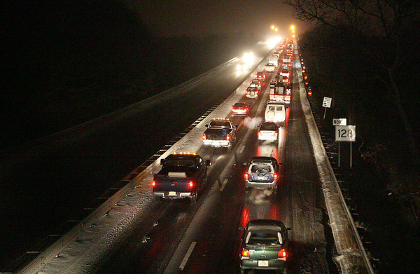 Gloucester: Snowy weather made for a difficult evening commute as several cars got stuck going over the A. Piatt Andrew Bridge, blocking northbound traffic. Photo by Kate Glass/Gloucester Daily Times