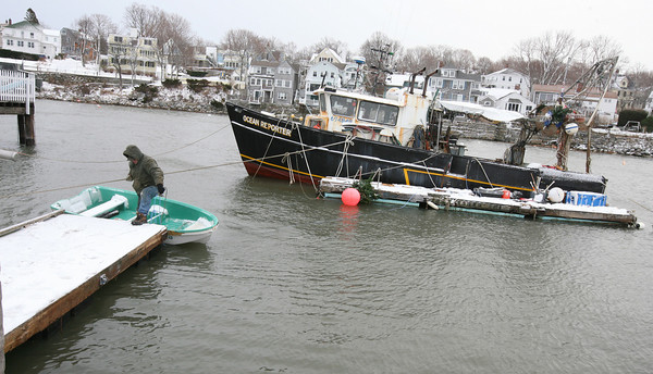 Rockport: Captain Bill Lee returns from his boat, the Ocean Reporter, after retrieving a dinghy, which had blown to the other side of the boat in the storm. Photo by Kate Glass/Gloucester Daily Times