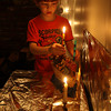 Gloucester: Treely Dowd of Gloucester lights the first candle on the menorah during the first night of Hanukkah last night. Photo by Kate Glass/Gloucester Daily Times Photo by Kate Glass/Gloucester Daily Times