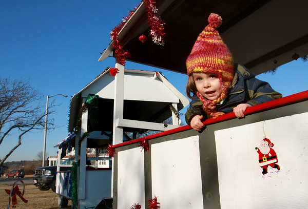 Gloucester: Ruby McElhenny, 2, plays on the Thomas the Train that is set up next to the Christmas tree at Kent Circle Saturday afternoon.  Ruby and her brother Luke, 4, stopped to check out the train while out for a walk with their parents.  Mary Muckenhoupt/Gloucester Daily Times