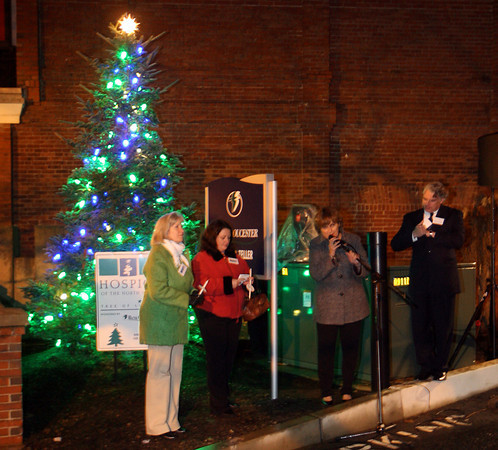 Gloucester: Cathy Carberry, Rev. Ronda Tyndall, Diane Stringer, President of Hospice of the North Shore, and Patrick Thorpe, President of BankGloucester, stand in front of Hospice of the North Shore's Tree of Lights as it is lit during a ceremony on Monday night. Photo by Kate Glass/Gloucester Daily Times