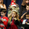 Gloucester: Third grader Brianna Alves, center, plays the recorder next to classmates Franky Bartholemew and Mari Roberts-Murphy during the Holiday Concert lead by music teacher David Benjamin at Veterans Elelemntary School. Grades three through five perfomed holiday songs for their families before school was released Friday afternoon. Mary Muckenhoupt/gloucester Daily Times