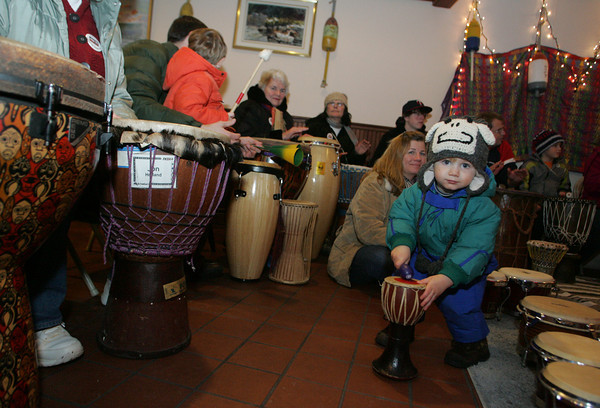 Rockport: Flynn Blanchard, 2, plays a tiny drum during the drum jam with Jon Holland and Dragon Company as part of Rockport New Year's Eve Friday night at the Fish Shack Restuarant. Mary Muckenhoupt/Gloucester Daily Times