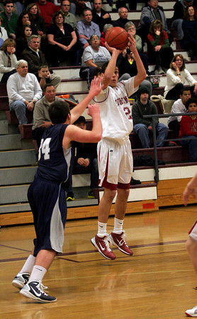 Gloucester: Gloucester captain Mike Tomaino shoots over Hamilton Wenham's Pat Hendrickson during the BankGloucester Holiday Tournament at the Benjamin A. Smith Fieldhouse last night. Photo by Kate Glass/Gloucester Daily Times