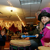 Rockport: Laura Dean, 6, drums to the beat during the drum jam lead by Jon Holand and Dragon Company at the Fish Shack Restaurant as part of Rockport New Year's Eve Friday night. Mary Muckenhoupt/Gloucester Daily Times