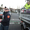 Rockport: Eric Beaulieu of the Rockport fire department carries toys off the Rockport Harbor Master's boat in Dock Square for the annual holiday toy drive Thursday afternoon.  Sen. Bruce Tarr and radio station 104.9 broadcast the toy drive as it stops in Essex, Manchester, Rockport and Gloucester. Also pictured is co-harbormaster Rosemary Lesch, right. Mary Muckenhoupt/Gloucester Daily Times