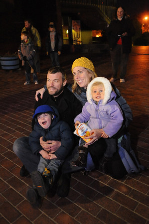 Marc and Margaret Chadbourne from Rockport sit with their children Henry 3, and Cecilia 1, and watch the lighting of the Lobster Trap Tree being lit up by Ed Collard Saturday night on Mian St. Desi Smith/Gloucester Daily Times. December 11,2010.