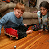 Gloucester: Ari Dimond-Putnam and Rebecca Dowd play dreidel as the celebrate the first night of Hanukkah last night. Photo by Kate Glass/Gloucester Daily Times